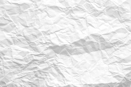 White wrinkled paper sheet. Creased pattern. Ecology problem concept. Abstract art background. Copy space.