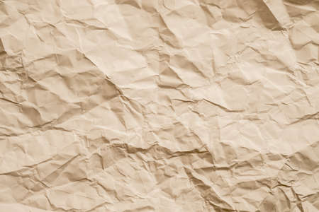 Blank beige crumpled paper. Wrinkled texture. Abstract art background. Copy space. Stock Photo