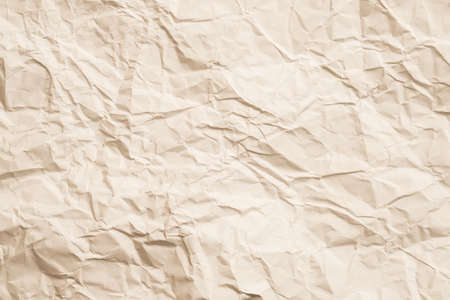 Blank ivory crumpled paper. Aged effect. Biodegradable material. Abstract art background. Copy space.
