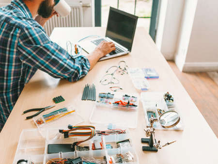 Technician lifestyle. Creative workplace. Elelectronic engineering tools and equipment. Фото со стока