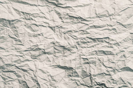 Blank gray crumpled paper. Crushed texture design. Abstract art background. Copy space.