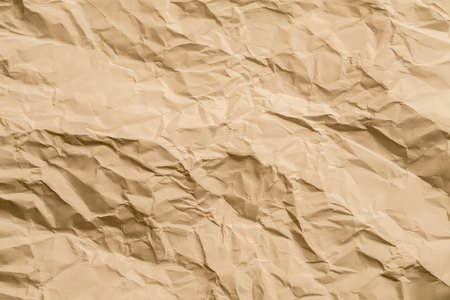 Beige wrinkled paper sheet. Cellulose industry. Abstract art background. Copy space. Stock Photo