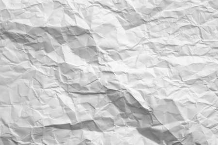 Blank white crumpled paper with gray shades. Aged texture. Minimalist design. Abstract art background. Copy space.