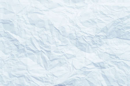 Blank sky blue wrinkled paper. Crushed texture. Waste recycling concept. Abstract art background. Copy space.