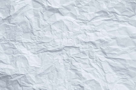 Blue toned white wrinkled paper. Aged surface design. Abstract art background. Copy space. 版權商用圖片 - 129911636
