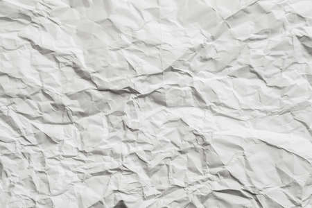 Blank white wrinkled paper with gray shades. Brushed texture design decorative layer. Copy space. 版權商用圖片 - 129911637
