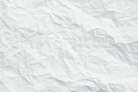White crumpled paper. Crushed texture surface. Decorative layer. Abstract art background. Copy space.