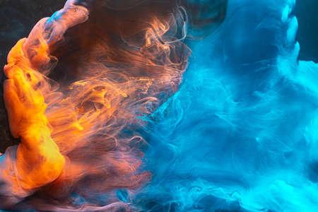 Ink water mix. Magic burst. Blue orange paint blend. Abstract art background. Stock fotó