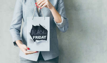 Black friday. Promotion sale discount. Woman with paper shopping bag.