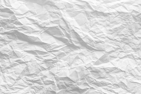 White wrinkled paper. Creased pattern. Biodegradable material. Abstract art background. Copy space. 版權商用圖片
