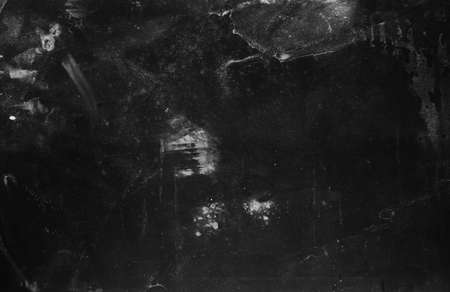 Grunge abstract background. Dust scratches. Black aged surface. White stains.