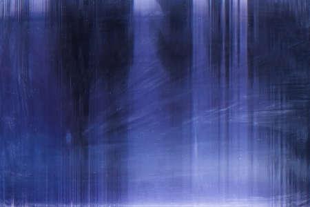 Blue lens flare. Old filmstrip texture. Blur gleam on dark background.