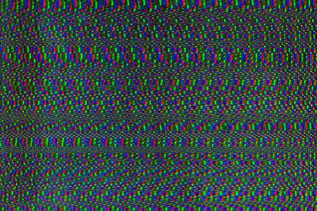 Distorted screen. Signal error. Green pink dot pixel pattern.