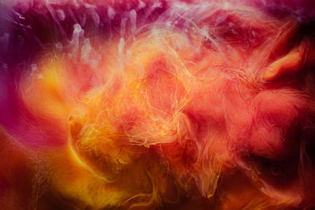 Smoke flow background. Magic poison. Yellow magenta dye blend.