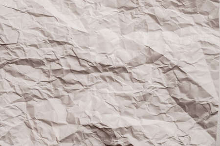 Brown wrinkled paper sheet. Creased pattern. Eco friendly material. Abstract art background. Copy space. 版權商用圖片 - 129911192