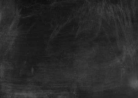 Dark scratched textured overlay. White dust on grunge background. Stock Photo