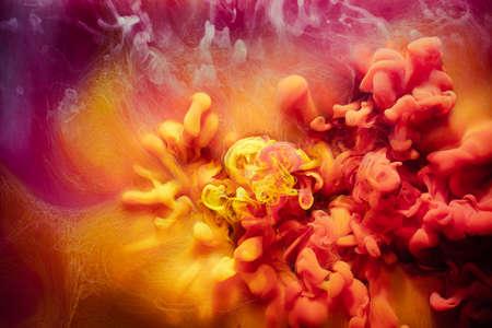Art background. Mysterious smoke. Yellow magenta acrylic paint.