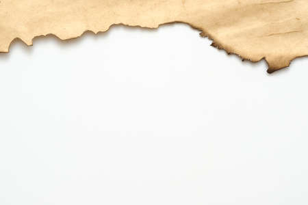Cropped shot of old beige paper with burnt edge on white background. Decorative abstract art design. Copy space. Stock fotó
