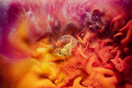Smoke background. Enchanted air. Yellow red paint mix.