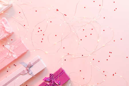Festive occasion present. Cropped flat lay of jewelry gift boxes on star pattern pink background. Copy space.