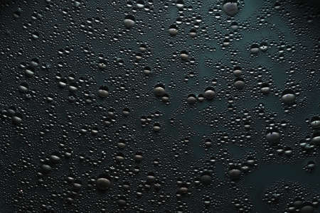Creative abstract art background. Water drops on gray surface. Bubbled texture effect.