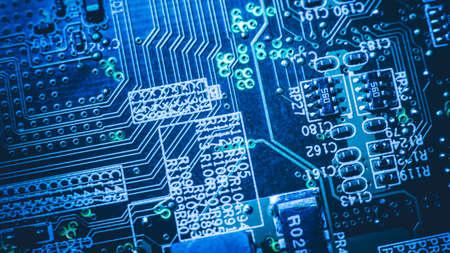 Microelectronics engineering. Printed circuit board. Blue glowing conductive tracks pads.