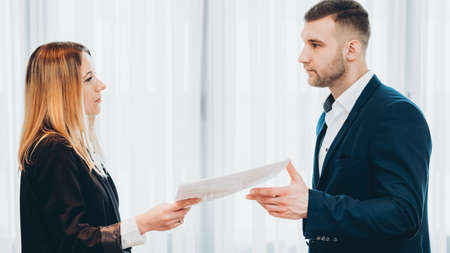 Quitting job. Female employee handing in resignation letter to male chief executive.
