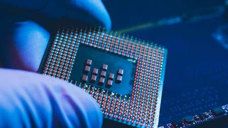 Computer maintenance. Electronic diagnostics. Engineer installing cpu to processor socket.