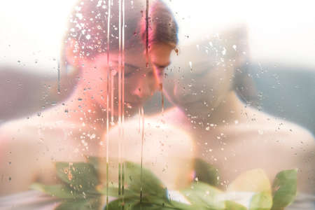 Art portrait. Surreal femininity. Peaceful woman blur silhouette in neon red bokeh light with scratches noise effect. Mindfulness tranquility. Nostalgic memories. Archivio Fotografico