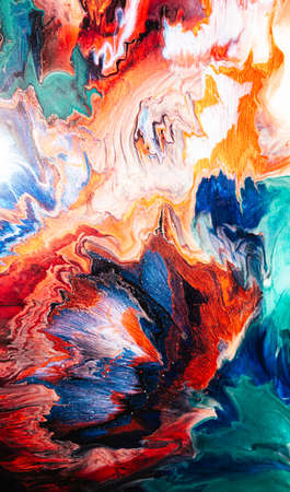 Color splash. Alcohol ink water. Marble texture. Orange blue gradient streak with sparkles effect. Fantasy abstract stained surface. Bright mineral stone pattern art background. Imagens