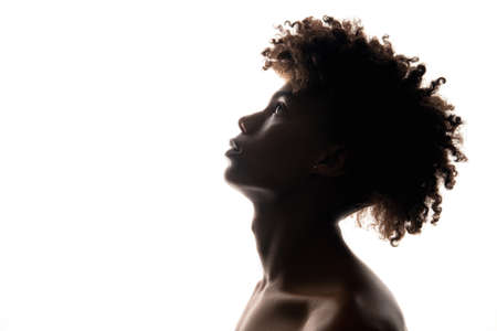 Black man silhouette. Masculine power. Profile portrait of confident african guy looking up isolated on white copy space. Ethnic problems. Independence freedom. Human tolerance