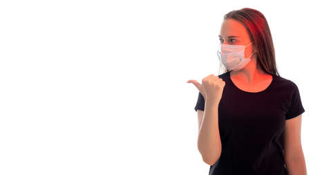 Quarantine measures. Disease prevention rules. Concerned woman in protective mask red glow pointing thumb copy space isolated on white. Stay home. Pandemic restriction. Advertising background