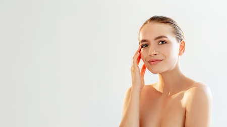 Skincare cosmetology. Face treatment. Portrait of pretty woman with nude makeup bare shoulders smiling isolated on light white copy space background. Beauty procedure. Detox therapy.