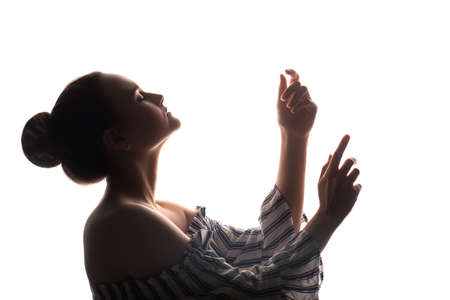 Recreation practice. Soul healing. Silhouette of inspired woman enjoying hypnotic hands movements with closed eyes isolated on white copy space background. Trance therapy. Tranquility relaxation.