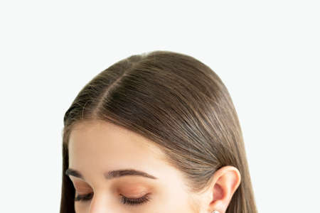 Hair treatment. Coloring procedure. Woman with perfect smooth parting hairstyle closing eyes isolated on neutral. Beauty salon. Dermatology shampoo