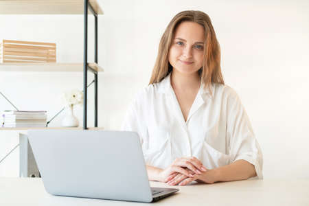 Freelancer lifestyle. Remote job. Professional career. Successful female leadership. Confident cheerful smart woman working from home office with laptop.