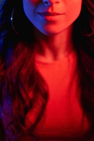 smiling woman neon light portrait face red color