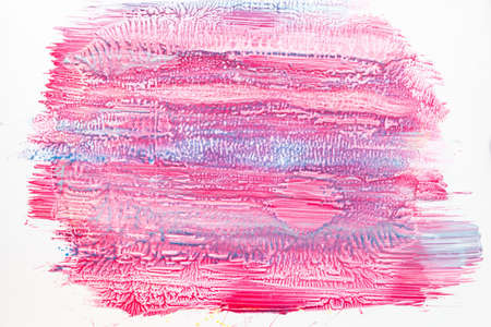 Pink nail polish background with blue smears. Bright varnish backdrop, manicure tool texture, free space. Cosmetic, abstract art, creative, beauty concept