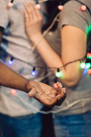 Marriage proposal, unrecognizable man with ring. Happy couple in love bound together. Surprise, happiness, tenderness and romantic feeling at holiday concept.