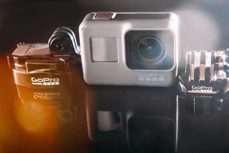 Kharkov, Ukraine - April 13, 2017: GoPro HERO 5 action camera with accessories on black background. Compact gadget waterproof, support 4k video, voice controls and is often used in extreme photography