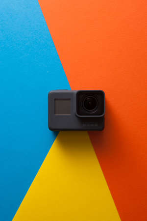 Kharkov, Ukraine - April 13, 2017: GoPro HERO 5 digital action camera on pop colors . Compact gadget waterproof , support 4k video recording, voice controls and is often used in extreme photography Editorial
