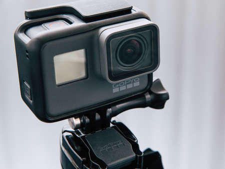 Kharkov, Ukraine - April 6, 2017: GoPro HERO 5 black edition digital action camera on tripod. Compact gadget waterproof , support 4k video, voice controls and is often used in extreme photography Editorial