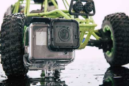 Kharkov, Ukraine - April 6, 2017: GoPro HERO 5 action camera in waterproof case. Rc car on backdrop. Compact gadget waterproof , support 4k video and is often used in extreme photography