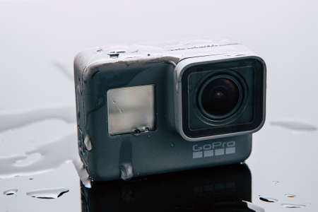 Kharkov, Ukraine - April 6, 2017: GoPro HERO 5 action camera in water. Compact gadget waterproof , support 4k video, voice controls and is often used in extreme photography