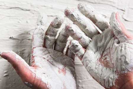 gyps: Hand White Plaster Closeup Repair Building Worker Dirty Stucco Construction Unrecognizable Concept