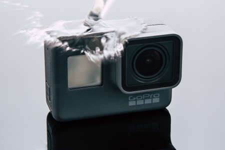Kharkov, Ukraine - April 6, 2017: GoPro HERO 5 action camera under water flow. Compact gadget waterproof , support 4k video, voice controls and is often used in extreme photography