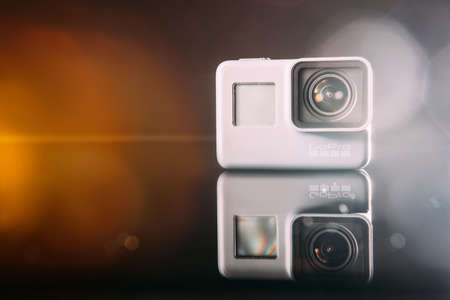 Kharkov, Ukraine - April 13, 2017: GoPro HERO 5 digital action camera with lens flare closeup. Compact gadget waterproof , support 4k video, voice controls and is often used in extreme photography