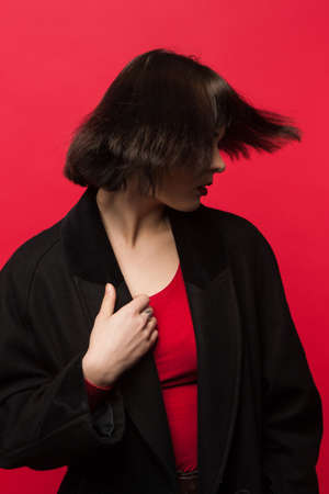 Fashion hairstyle. Female with short haircut. Creative model photoshoot, unrecognizable woman, beauty concept