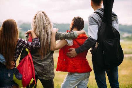 Friendly hugs admire nature tourism concept. Travelers group unity. Stock Photo