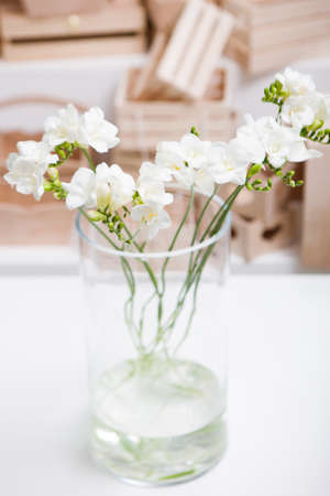 Splendid Bunch Of White Orchid In Glass Vase On Table And Wooden